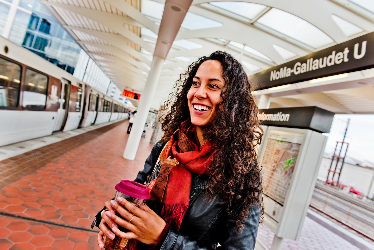 Smiling_on_metro_platform.jpg