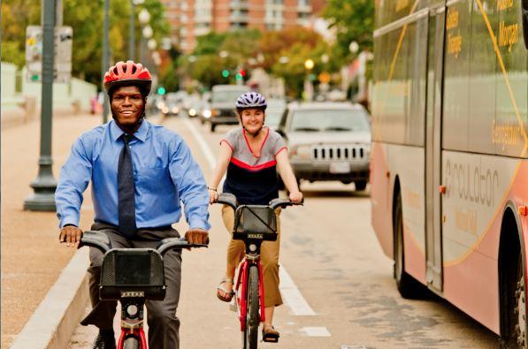 Two_people_biking.jpg