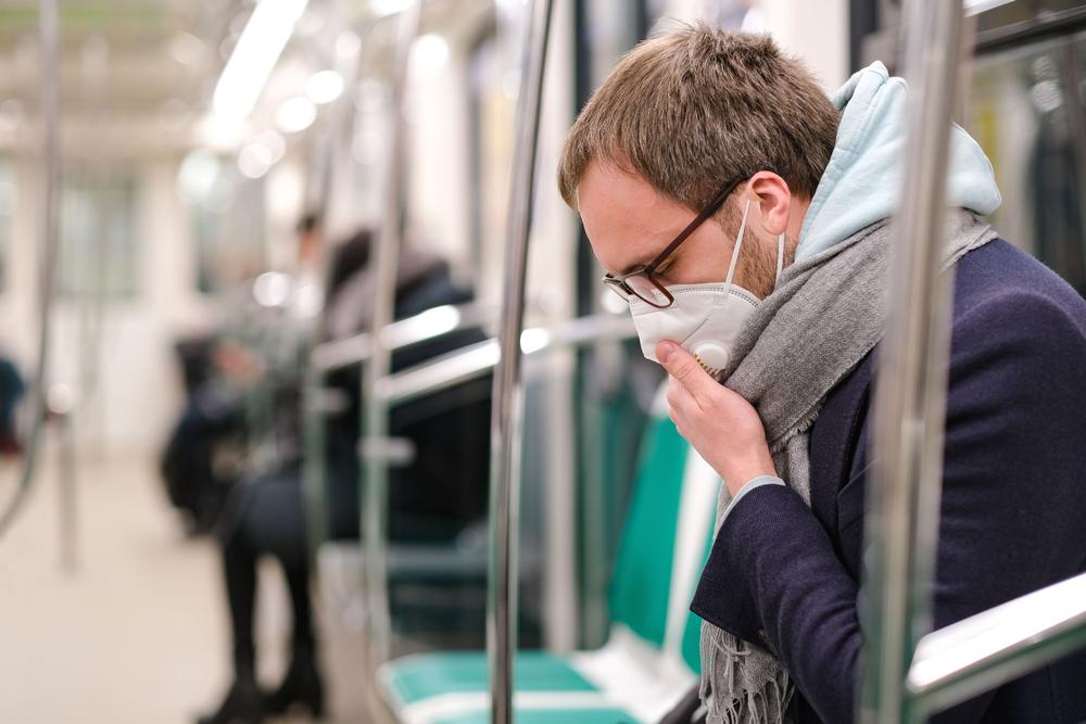 Man wearing mask on metro