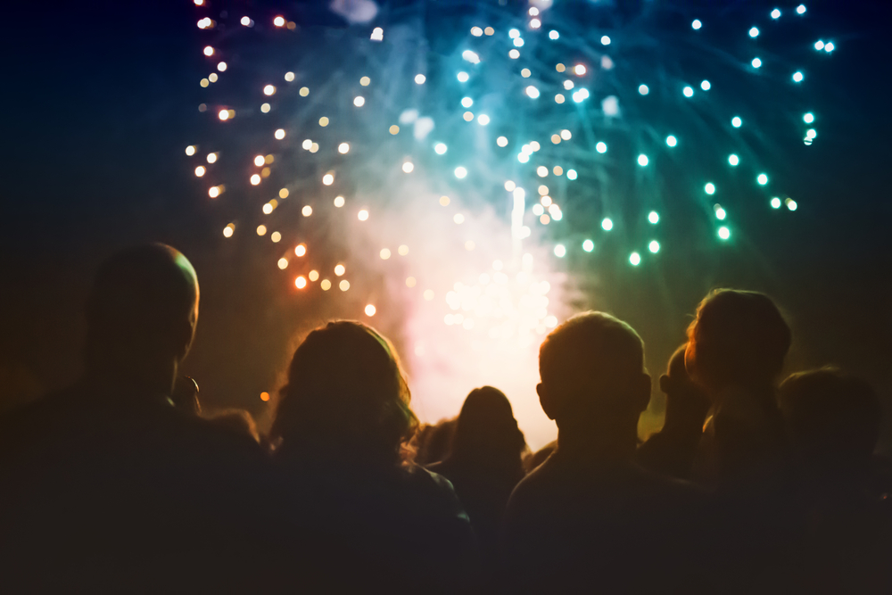 Group of people watching fireworks